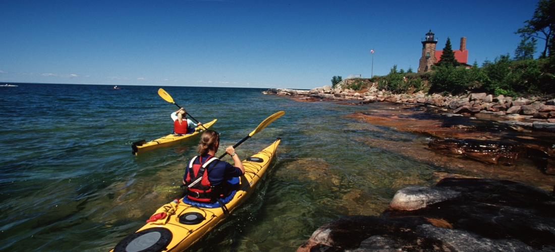 Kayaking the Apostle Islands - Discover Wisconsin's beautiful cities, towns and beautiful landscapes.  Wisconsin is for adventure!  From its lush forests and rolling hills to magnificent beaches - Wisconsin is a Vacation and Adventure Destination you will enjoy.  See America - See Wisconsin -a USA Travel Guide Destination!