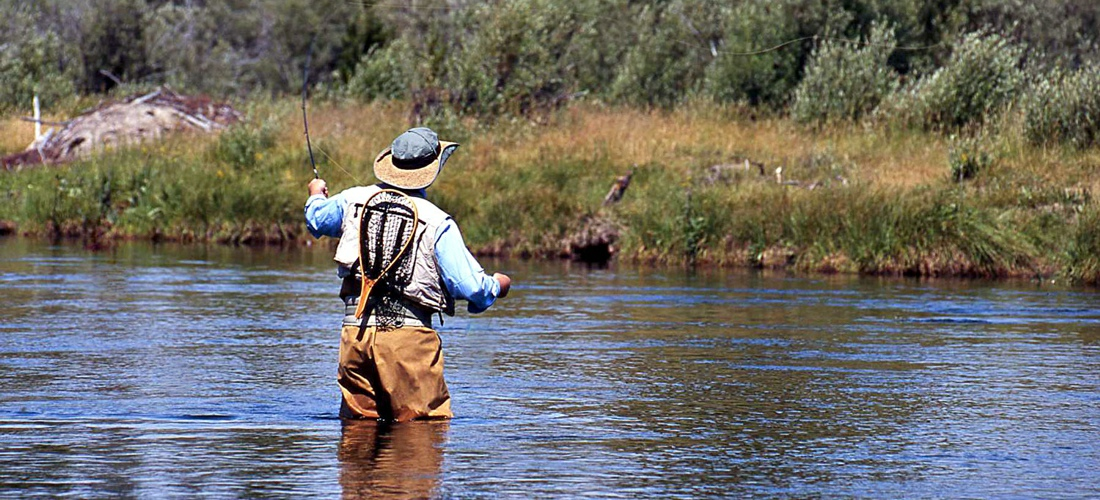 Fly fishing the Madison River in Montana - USA Travel Guide.