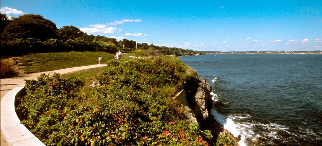 The Newport Cliff Walk is considered one of the top attractions in Newport, Rhode Island, in the United States. It is a 3.5-mile (5.6 km) public access walkway that borders the shore line. It has been designated a National Recreation Trail.  See America