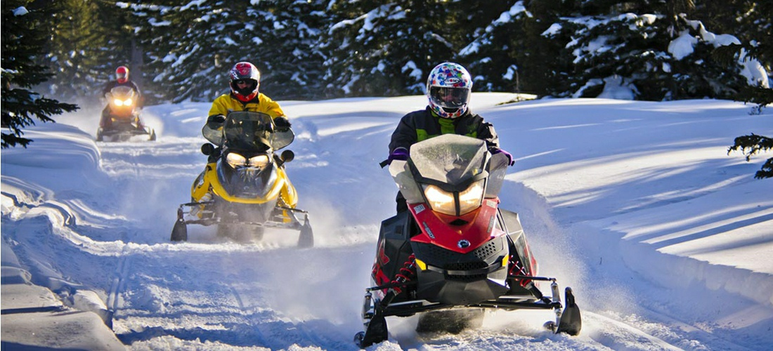 Snowmobiling is a very popular winter activity in the beautiful landscapes of South Dakota.