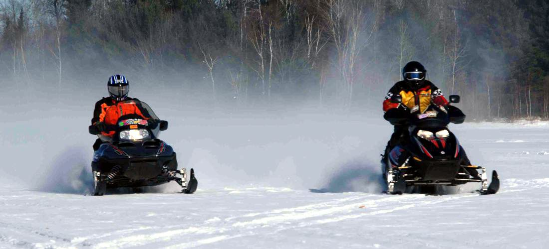 Snowmobiling - Discover Wisconsin's beautiful cities, towns and beautiful landscapes.  Wisconsin is for adventure!  From its lush forests and rolling hills to magnificent beaches - Wisconsin is a Vacation and Adventure Destination you will enjoy.  See America - See Wisconsin -a USA Travel Guide Destination!